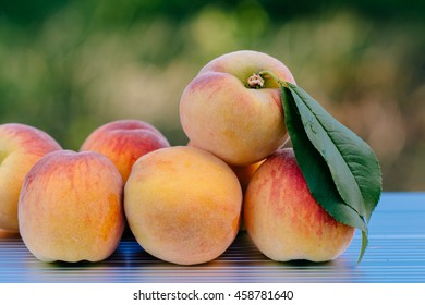 A small amount of peaches is pile on the ladder