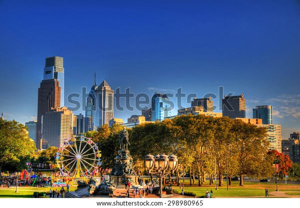 A small amusement park with the background of the skyline of philadelphia in high dynamic range (HDR)