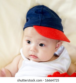 small asian baby wearing a hat.