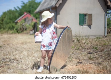Small assistant of photografer. Super cute kid with metal reflector in a hand helping in a outdoor photo session.