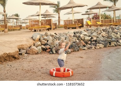 aa827c6485bc2 small baby boy or cute child with adorable face and blonde hair in shirt  and shorts