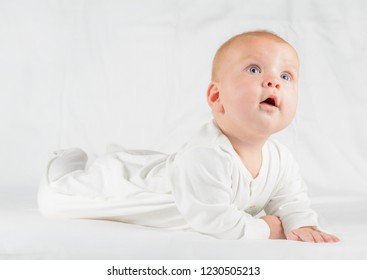 small baby crawling and looking up