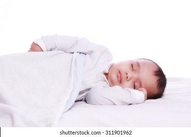 Small baby sleeping Under white blanket , Photographed against white background