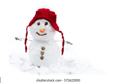 A small baby snowman with red hat and a smile on his face