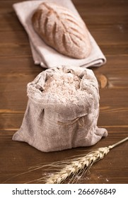 Small bag of flour and bread loaf