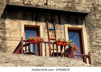 Small balcony on old stone house in Mostar , Bosnia and Herzegovina