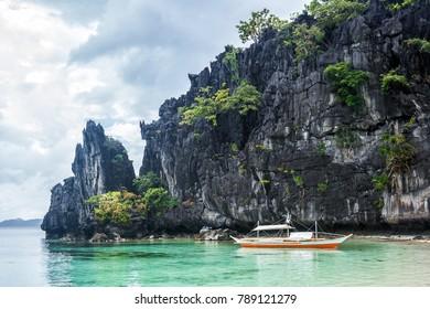 Small bangka boat on the bay of El Nido, Philippines