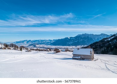 A small barn covered in snow during the Swiss winter
