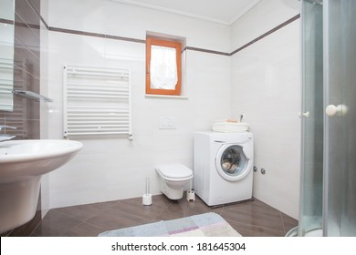 small bathroom with shower and washing machine