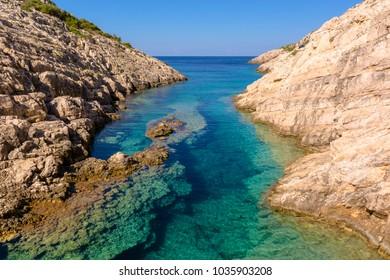 Small bay with crystal sea water. Korakonisi Island on western side of Zakynthos. Zante, Greece