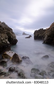 Small bay near Big Sur, California, with silky water and rocks