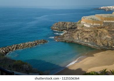 Small bay with sand beach at Obama resort, Tenerife island, Spain.
