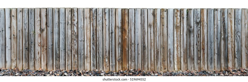 A small beach fence made from  round vertical pine logs without bark. Isolated on top