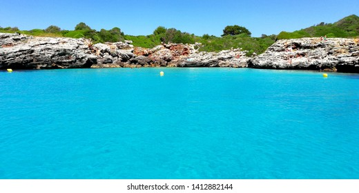 Small beach in the south of Menorca perfect to take a bath with no people around