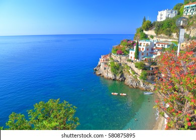 Small beach and traditional buildings above the sea on Amalfi coast, Italy