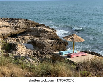 Small beach for two. Scenery rocks of Adriatic coast. Blue Mediterranean sea.  Cliffs and wild herbs. Wonderful seascape. Sunny day. Secluded quiet place for relax. Summer holiday in Montenegro