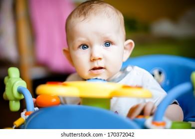 Small beautiful baby in a walker.