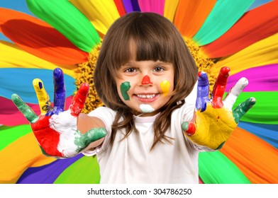 The small beautiful girl has stretched to a camera of a palm soiled in a paint of different colors, smiles