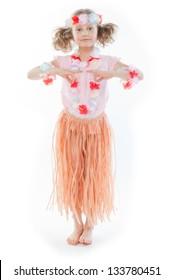 Small and beautiful girl in Hawaiian dress