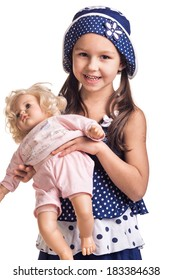 The small beautiful girl plays together with a doll, on white background.