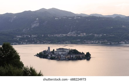 The small and beautiful  island of San Guillio in Lake Orta in the evening in Italy, Europe