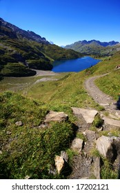 The small beautifull lake in swiss mountains with  hiking path and stones