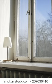 Small bedroom lamp on the window sill