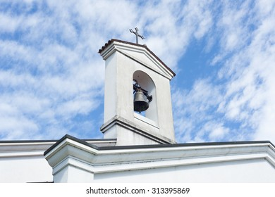 Small bell tower with a bell of a country church i