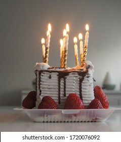 Small birthday, strawberry cake with lighten birthday candles