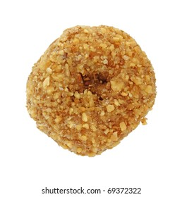 A small bite sized donut with coconut flakes on a white background.