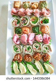 Small bites with salami, ham and cheese, top view