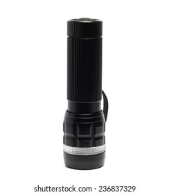 small black flashlight on a white background