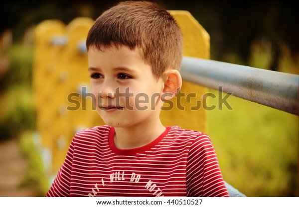 small black-haired boy on the street