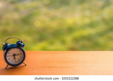 Small blue alarm clock. Good morning concept.