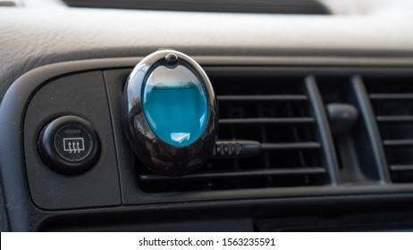 Small Blue AutoFresh Car Air Freshener from Kmart on an air conditioner in a car