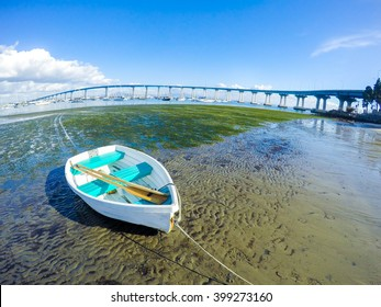 Small Blue Boat on the Beach