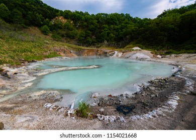 Small blue pond of hot spring in mountain