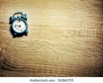 small blue watch on the table
