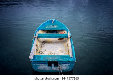 Small blue wooden rowing fisherman boat in the port and harbour in the Alykes Bay in Zante, Greece