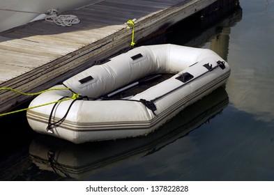 Small boat alongside in Jetty