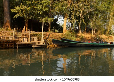 Small boat among the floating gardens and canals of  Inle Lake,  Myanmar (Burma)