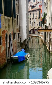 Small boat and  canal in Venice, Italy