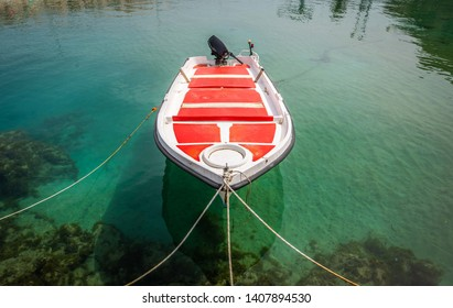 Small boat in green water