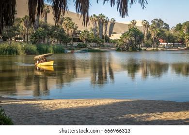 Small boat at Huacachina Oasis Lake - Ica, Peru