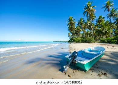 Small boat landed on the shore of a rustic beach on a remote island off the coast of Bahia Nordeste Brazil