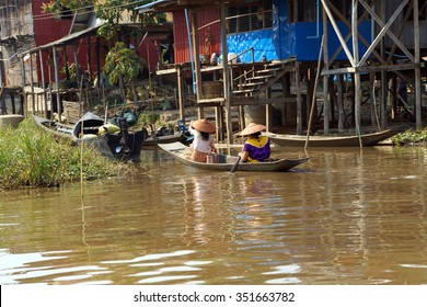 Small boat moves through canals of  Inle Lake,  Myanmar (Burma)