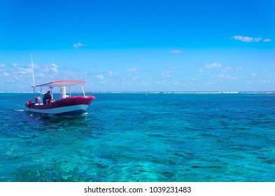 Small boat on Cancun Sea