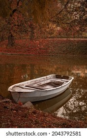 Small boat on a lake in Jardin Public park in Bordeaux in Autumn during the month of October