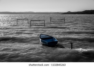 Small boat on troubled water waves