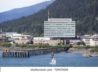 The small boat passing by Juneau downtown, the capital of Alaska.